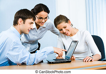 Teamwork - Photo of businessman demonstrating a computer...