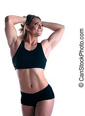 Athletic woman body builder posing isolated
