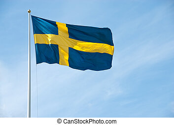 Flag of Sweden in the blue sky - Swedish flag waving in the...