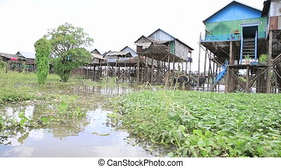 Floating village - Homes on stilts on the floating village...