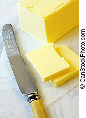 Butter - Block of butter, cut with bone-handled vintage...