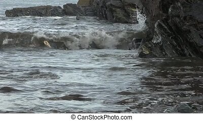 Sea waves splashing on rocks.