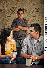 Family With Problem Child - Young Latino family with...