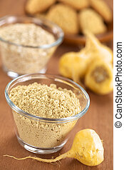 Maca Powder - Maca powder flour in glass bowl with maca...