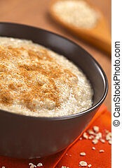 Oatmeal Porridge with Cinnamon - Bowl of cooked oatmeal...