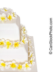 Wedding Cake with Frangipani - Close-up of tiered wedding...