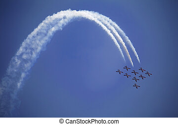Air Show - The view of several jet plane in formation. White...