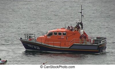 Life boat aiding a boat - Life boat aiding a boat of the...