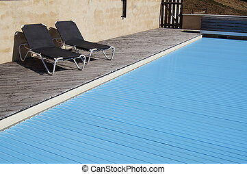 Swimming pool with safety cover to prevent accidental...