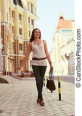 Young Happy Woman on the Urban Street