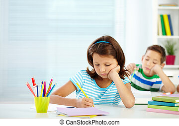 Schoolgirl at lesson - Portrait of serious girl drawing at...