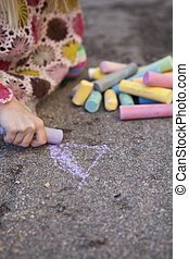 Drawing with chalk - Cute little girl drawing with chalk...