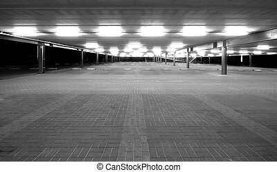 Empty parking lot - an empty spacious parking lot by night...