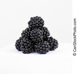 Blackberrys - A pile of Blackberry fruits on a white...