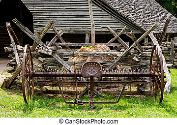 Old Farm Cultivator - Old cultivator sitting on an old...