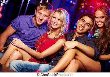 Young clubbers - Image of happy couples at party in the...