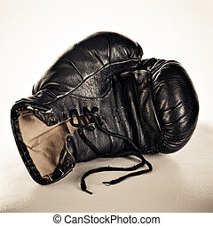boxing glove on a brown background