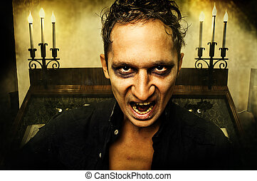 Male vampire with evil eyes opening mouth
