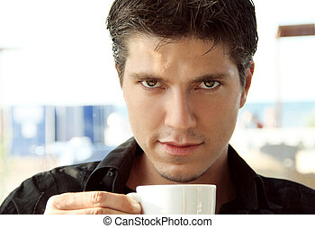 Elegant young handsome man with cup