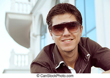 Handsome man in sunglasses, photo of young male model