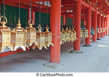 Lanterns in Japan - Row of beautiful gold lanterns hanging...