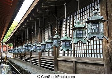 Lanterns in Japan - Row of beautiful lanterns hanging from...