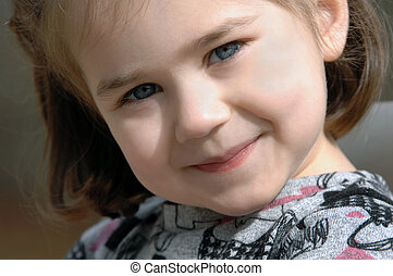 Eyes Alight - Adorable little girl beams at the camera....