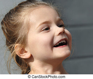 Happy and Spontaneous - Little girl laughing responds to...