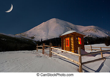 A small chapel in the mountains at the winter. Night with...