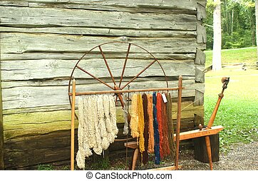 Antique spinning wheel - An old antique spinning wheel with...