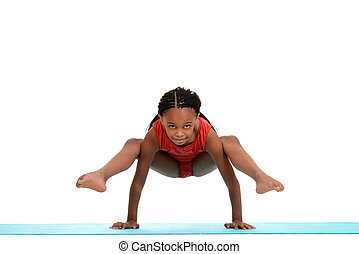 Young girl doing gymnastics move - isolated Young girl doing...