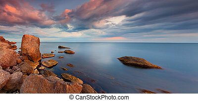 Colorful panorama of the sunset on the sea