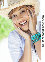 Beautiful Mixed Race Woman Laughing In Straw Cowboy Hat