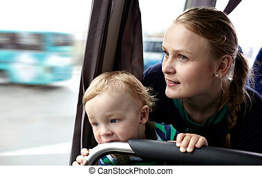 Mother and son travel by bus - Young mother with her 16...