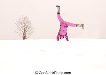 Winter sports exercises on the background of lone tree
