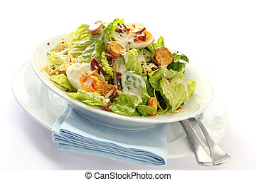 Caesar Salad - Caesar salad in a white bowl with blue...
