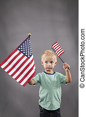 Young Boy Waves Flags