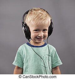 Boy Smiles With Headphones