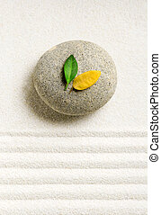 Zen - Stone on white raked sand with a leaves on a top. Zen...