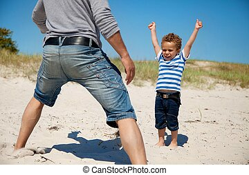 Energetic Kid Raises Arms - Father together with his young...