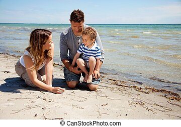 Family Enjoying Bonding Time on the Beach - Portrait of a...