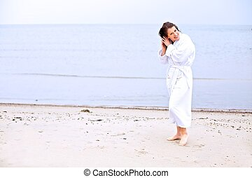 Young Woman on a Beach Fixing Her Hair
