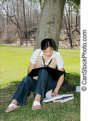 asian girl student - cute asian korean girl outside studying...