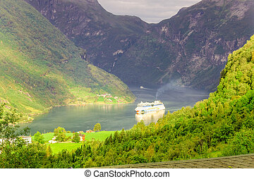 Cruise ship in Geiranger fjord - GEIRANGER, NORWAY-AUGUST...