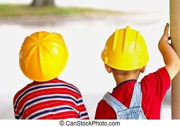 Little Constructors - Two boys wearing toy construction hard...