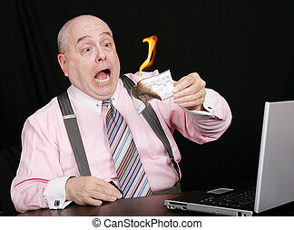 paycheck up in smoke - surprised businessman watching his...