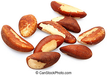 Nine fresh brazil nuts raw over white