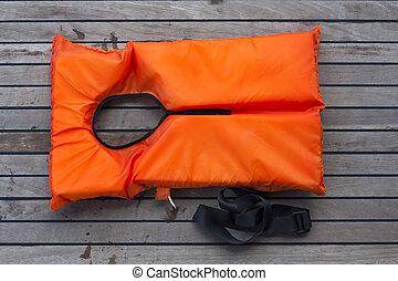 Orange life jacket.