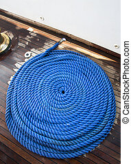 Ship rope texture wave closeup background helix on wood....