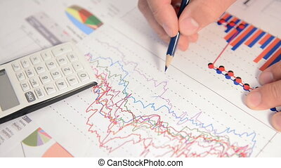 Businessman analyses financial charts